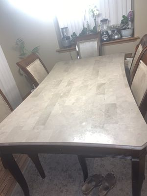 7 piece granite top kitchen table with leather and wood chairs for Sale in West Bloomfield Township, MI