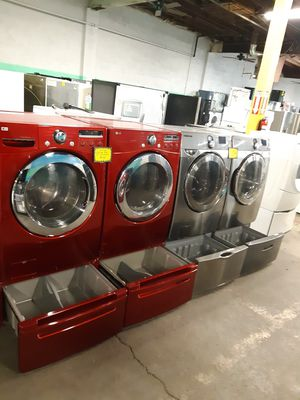 LG FRONT LOAD WASHER AND DRYER SET WITH PEDESTAL WORKING PERFECTLY 4 MONTHS WARRANTY for Sale in Baltimore, MD