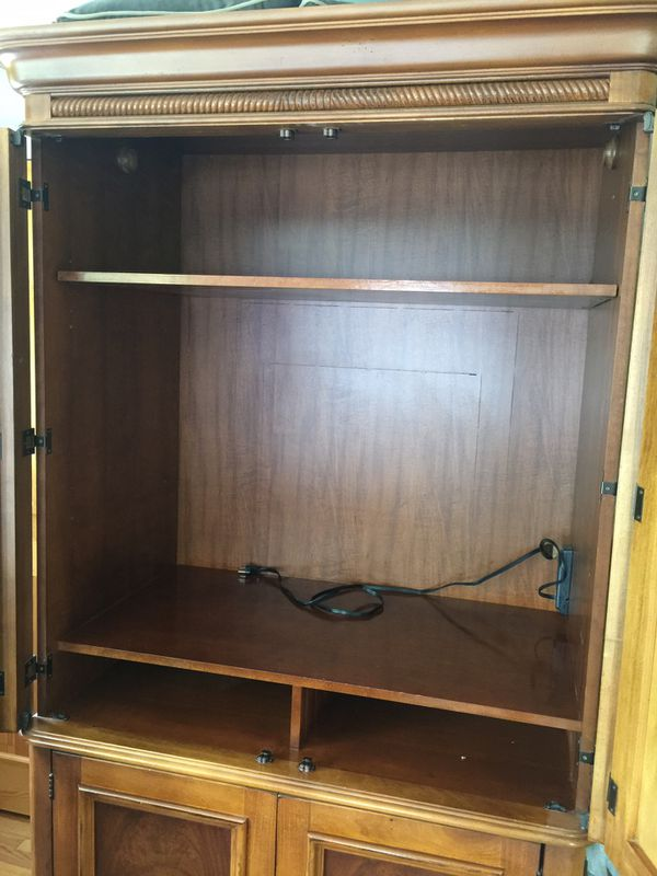 Wardrobe Cabinet made by Hooker Furniture. Has pull out drawers below. Above for hanging cloths of removal shelf. This is made in USA abd real high q