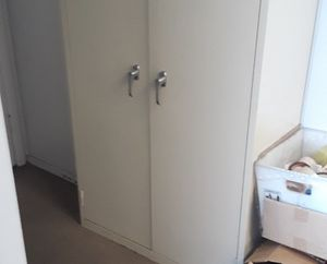 Metal 2 door supply cabinet $120 and shelves starting at $20. for Sale in New Brunswick, NJ