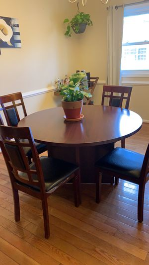 Wooden dining set with 4 chairs it's almost new in very good condition. for Sale in Manassas, VA