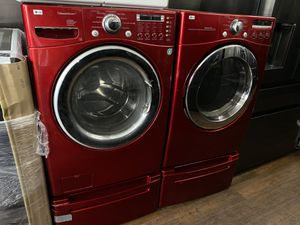 Lg he front load washer and dryer set with original pedestals for Sale in San Juan Capistrano, CA