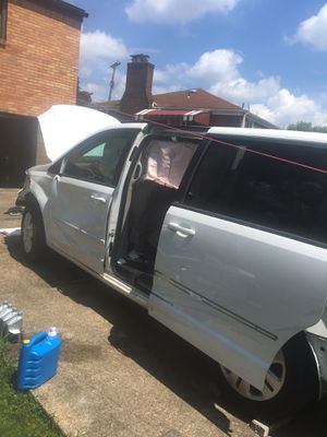 Dodge and Chrysler mini van parts out front 2014 dodge caravan for Sale in Pittsburgh, PA