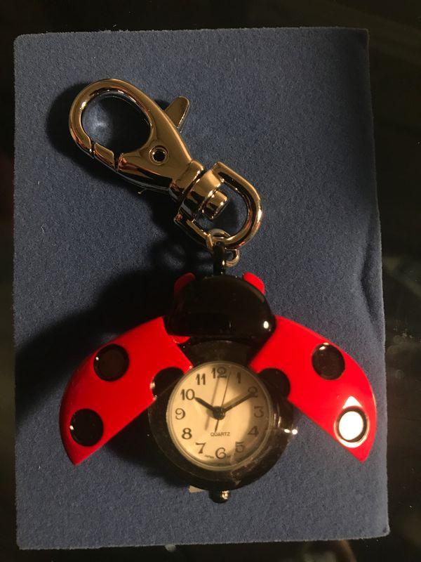 Avon Ladybug clip watch