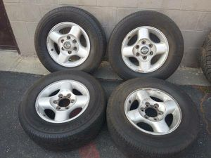 6 lug aluminum Nissan frontier rims. 16 inch with old tires for Sale in Montebello, CA