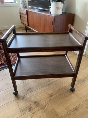 Midcentury bar or tea cart. I used as a bookcase. Lightweight and is in fair condition but super cute. for Sale in Alexandria, VA
