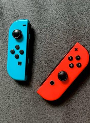 Nintendo switch red and blue joy-cons for Sale in Charlotte, NC