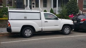 White Toyota Tacoma 2010 with cap for Sale in Silver Spring, MD