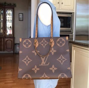 Authenticity guarantee my vuitton onthego GM giant monogram for Sale in Seattle, WA