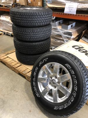 """Jeep Wrangler 18"""" OEM alloy wheels and Tires for Sale in Pompano Beach, FL"""