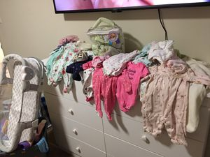 Newborn onsies, pants, shoes, swaddle me swaddles, swaddle me sleep used once, shoes, 50 breast milk bags NEw.not everything pictured for Sale in Washington, DC