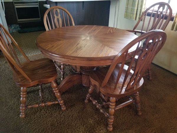 Oak dining room table with 6 oak chairs {contact info removed}