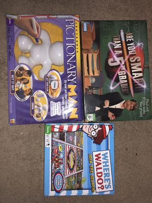 Board game set (where's Waldo, Pictionary Man, Are you smarter than a 5th grader) for Sale in Gresham, OR