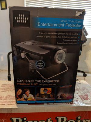 The sharper image entertainment projector for Sale in Pompano Beach, FL