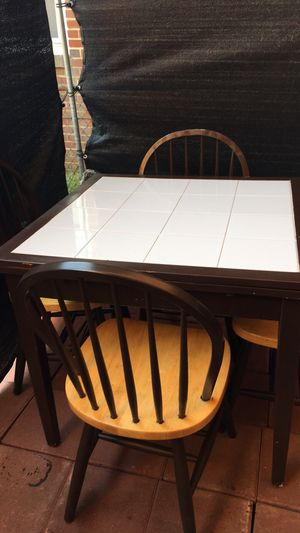 Dining table white tiles with both side extensions 4 chairs for Sale in Washington, DC