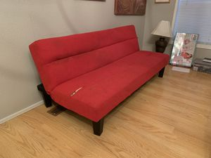 Red small kids futon couch has a couple rips in it for Sale in Puyallup, WA