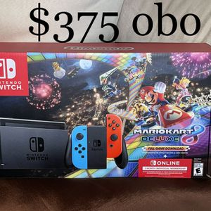 Nintendo Switch w/ Mario Kart Digital Download and 3 Month Nintendo Online Membership for Sale in Madera, CA