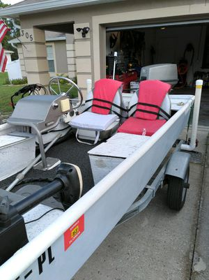 50 HP johnson engine , 15 ft fiberglass jon boat with trailer, 2 6 gallon fuel tanks for Sale in Kissimmee, FL