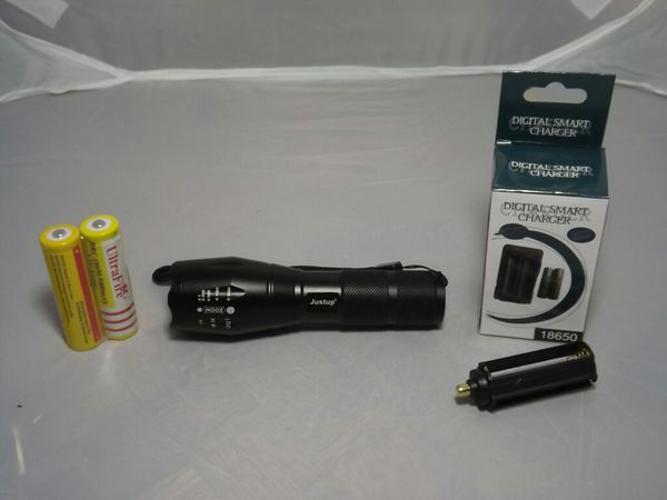 Flashlight with charger and rechargeable battery