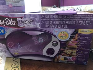 Easy Bake Oven with two cooking trays, pan tool, Instructions Booklet and extra never opened baking mixes and sprinkles. for Sale in Douglasville, GA