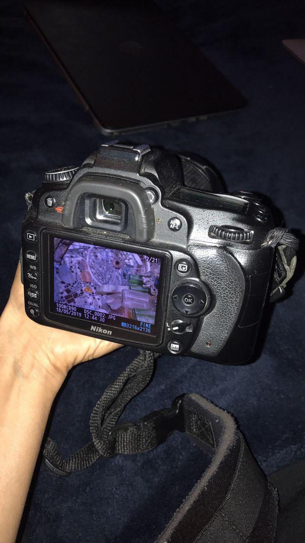 D90 Nikon DSLR with 18-200mm lens