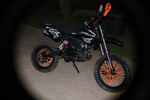 125 cc dirt bike with matching helmet goggles and gloves for Sale in Baton Rouge, LA