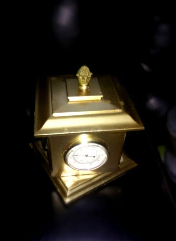 Metallic gold spinning clock *antique*