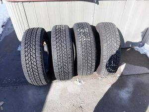 4 Goodyear studded snow tires. 215/60R 16. Great shape. for Sale in Cheyenne, WY
