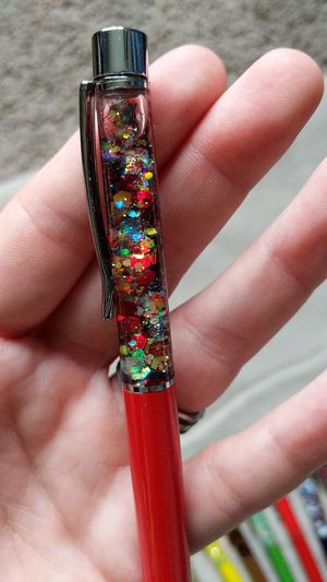 Glittered pen black ink NEW. Twist the bottom to use. Check out my other glittered pens for Sale in Hazelwood, MO