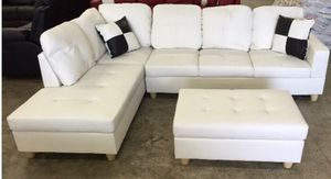 White leather sectional couch and storage ottoman for Sale in Bothell, WA