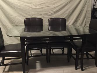 Dinning Table With Glass Top 6 Leather Chairs for Sale in Zephyrhills,  FL