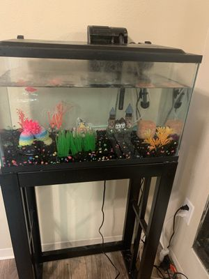 10 gallon Fish tank with stand filter decor One GloFish Included heater also has a bubble wand for Sale in Tacoma, WA
