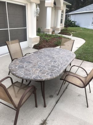 Patio set marble table and 4 chairs can be deliver if needed for Sale in Hudson, FL