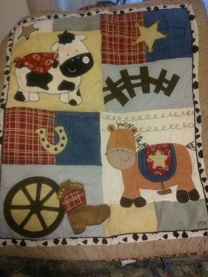Round Em up baby bedding cowboy Set . Hard to find not made anymore. Bed skirt crib sheet diper stacker 4 bumper guard's musical mobile for Sale in Denver, CO