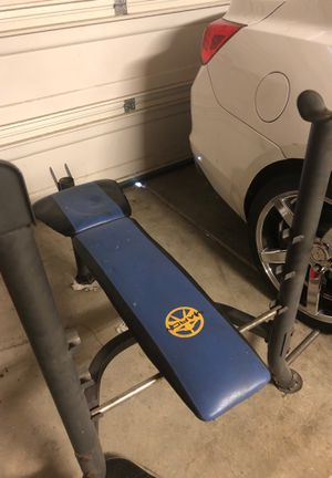 Weight bench and Olympic weights and bar for Sale in Fresno, CA