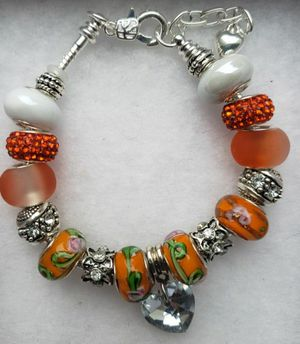 Orange charm bracelet 1 for $15 or 2 for $25 for Sale in Baltimore, MD