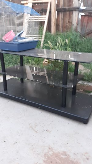 Black 3 tier glass and metal table for Sale in Phoenix, AZ