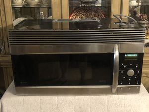 GE stainless steel over range microwave excellent condition for Sale in Henderson, NV