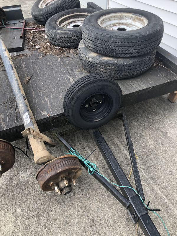 Dexter brand 3,500 lb axles w/ wheels and tires. Truck, trailer