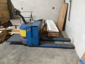 Electric pallet jack . With stand on back for Sale in Arlington, VA