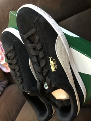 Women size 9.5 which is a 8 in men puma suede for Sale in Haines City, FL