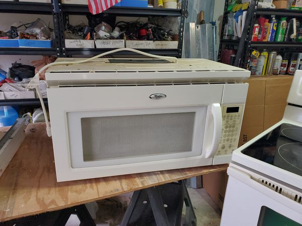 Complete kitchen appliance set. Refrigerator, stove, microwave and dishwasher.