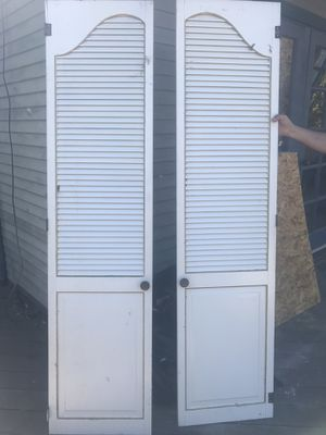 Free items at curb! Closet doors, built-in ironing board, wood cabinets, succulents and more! for Sale in San Diego, CA