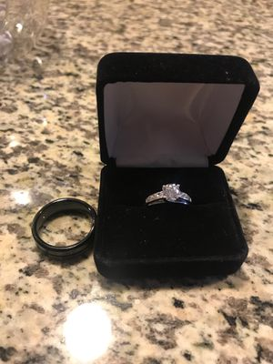 2 rings male black tungsten size 11 female silver size 6 for Sale in Houston, TX