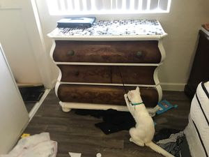 1 large wood dresser. 1 medium dresser and 1 wicker end table for Sale in Mesa, AZ