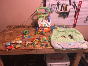 Assorted baby toys and shopping cart cover. for Sale in Murfreesboro, TN