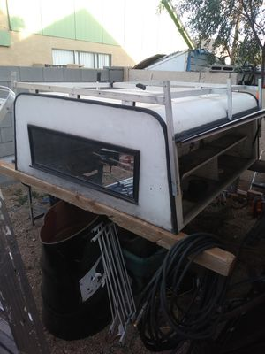 Midsize camper shell Rack on top Side compartment for tools All windows are good It measures 62 1/2 in across 75 in long 26 in tall 230.00 for Sale in Glendale, AZ
