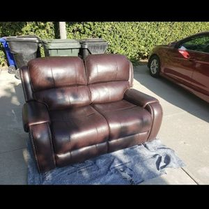 Brand new $2600. Ashley's leather electric reclining loveseat. Been turned on once. for Sale in Rancho Cucamonga, CA