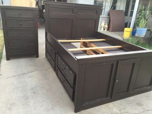 Full bed frame with double storage and eight drawers and one tall dresser with five drawers all drawers open fine. for Sale in Fresno, CA
