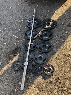 Olympic weights and barbell for Sale in Lombard, IL